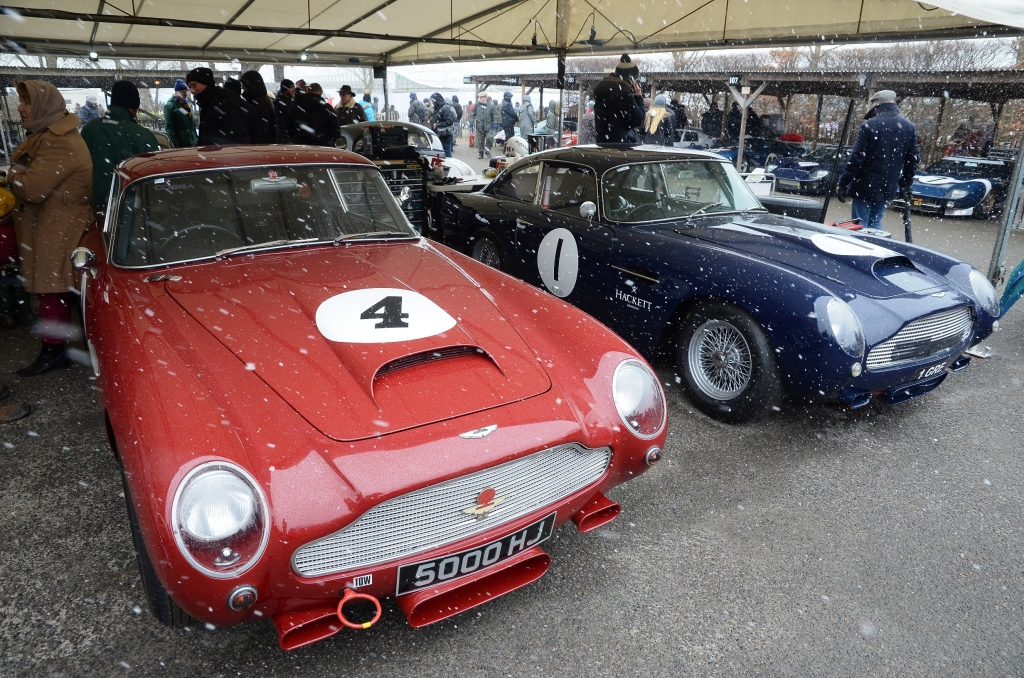 Aston Martin DB4GTs hiding in the paddock from the snow